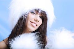 Winter girl wearing white fur hat Stock Photo