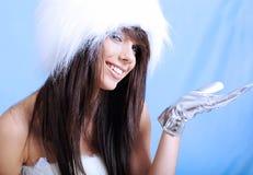 Winter girl wearing white fur hat Royalty Free Stock Photography