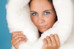 Winter girl in white fur Stock Photos