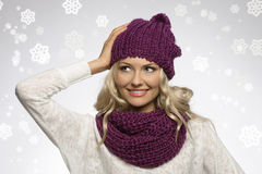 Winter girl in white with purple hat and fake snow Stock Photography