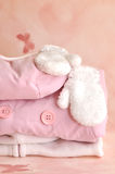 Winter Girlie Clothes. Pile of pink girlie warm winter clothes stock photos