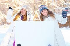 Winter. Girls with blank banner. Stock Images