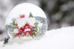 Winter glass ball. On snow stock image