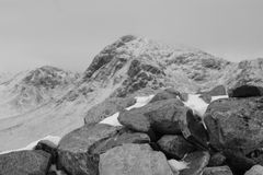 Winter in Glencoe. Black and white photo looking over a snow covered Glencoe, Scotland from a cairn at the top of The Devils Staircase Stock Image