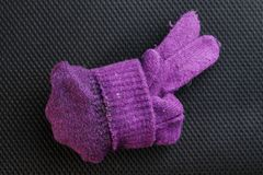 Winter glove put on dark background scene. Stock Photography