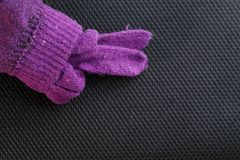 Winter glove put on dark background scene. Stock Images