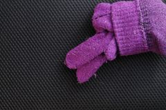 Winter glove put on dark background scene. Stock Photo