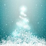 Winter glowing spruce from snow. On blue background. Christmas snowflakes tree star shines from above Royalty Free Stock Photo