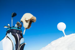 Winter golf. Tee, golf ball and equipment in snowy landscape Stock Photo