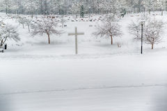 Winter graveyard. Winter landscape with a distant grave yard royalty free stock photos