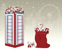 Winter greeting card. With famous red English telephone booth and Santa s gifts bag on London city background. Merry Christmas in UK. Postcard or Invitation for Royalty Free Stock Images