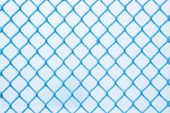 Winter, a grid of fence, covered with hoarfrost, a frosty winter. Day Royalty Free Stock Photos