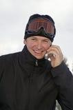 Winter groom. Winter wedding groom on cell phone checking on bride Stock Photo