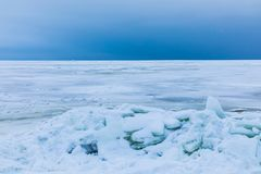 The winter gulf of the sea covered with snow and ice stock photography