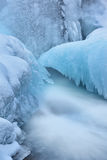 Winter, Gull Creek Cascade. Winter landscape of cascade captured with motion blur and framed by blue ice, Gull Creek, Michigan, USA Stock Photography