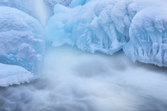 Winter Gull Creek Cascade. Winter landscape of cascade captured with motion blur and framed by blue ice, Gull Creek, Michigan, USA Royalty Free Stock Image