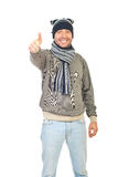 Winter guy giving thumbs stock photos