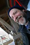 Winter Guy Happy. A smiling, middle-aged man with beard and mustache. He is wearing a blue knit cap and a thick black coat Royalty Free Stock Images