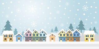 Winter-Häuser mit schneiendem Hintergrund Lizenzfreie Stockfotos