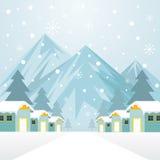 Winter-Häuser mit schneiendem Hintergrund Stockfotografie