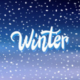 'Winter' handwritten text on snow background Royalty Free Stock Image