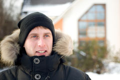 Winter - happy man in cap and warm jacket Royalty Free Stock Image