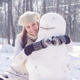 Winter Happy Woman And Snowman Stock Photography