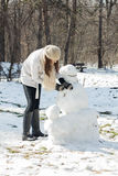 Winter Happy Woman And Snowman Royalty Free Stock Photography