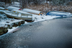 Winter harbor. Rowboats at a frozen lake in winter royalty free stock photos
