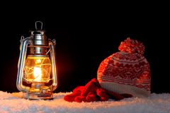 Winter hat gloves and lantern Royalty Free Stock Images