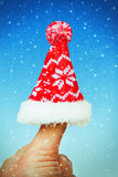Winter hat on thumb Royalty Free Stock Image