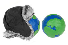 Winter hat and two plasticine Hemisphere Stock Image