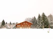 Winter-Haus Stockbild
