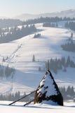 Winter haystack in Carphatian mountains Stock Photography