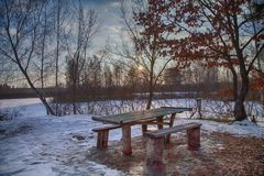 Winter hdr sunset sky landscape picnic area outdoor weekend holiday travel. BBQ concept with table and bench. outdoor. Activities, Wonderland royalty free stock photography