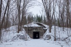 Winter. Hidden in the forest entrance to the secret soviet military bunker, echo of cold war Royalty Free Stock Photos