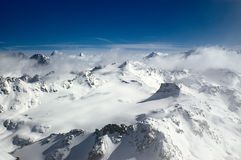 Winter high mounatins. Panoramic view on  cloudy snow winter mountains. Alpes, Switzerland, Europe Stock Images