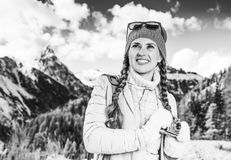 Traveller woman with vintage photo camera looking into the dista. Winter on higher level of fun. happy modern traveller woman in South Tyrol, Italy with vintage Royalty Free Stock Images