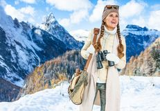 Traveller woman with binoculars looking into the distance Stock Photography