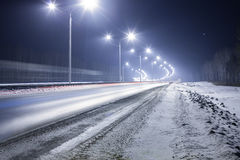 Winter highway at night Royalty Free Stock Photography