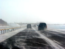 Winter highway during snow storm. Poor visibility Royalty Free Stock Image
