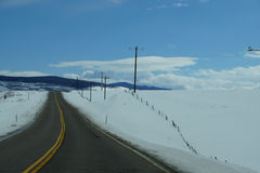 Winter highway with telephone poles Royalty Free Stock Photo
