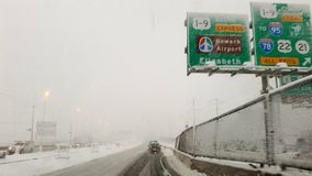 Winter highway to Newark Airport. View of a highway during a winter storm toward Newark Airport in New Jersey (USA stock photos