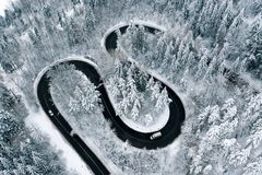 Winter highway trough a fostes aerial view from a drone royalty free stock photography