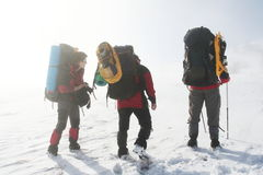 Winter hike. Climbers in the winter hike Stock Photo