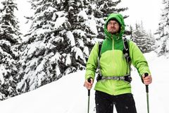 Winter hike in white snowy woods, man hiking stock photography