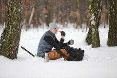 Winter hiker having break for sandwich and cup of tea Royalty Free Stock Photo