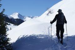 Winter hiking. Men hiking in mountain winter Stock Photos