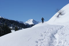 Winter hiking. Men hiking in mountain winter Royalty Free Stock Image