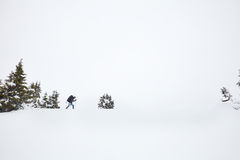 Winter hiking in Alps Stock Image
